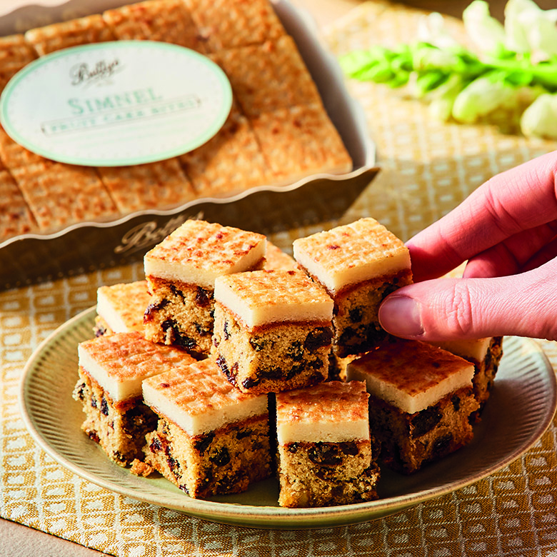 Simnel Fruit Cake Bites with Hand